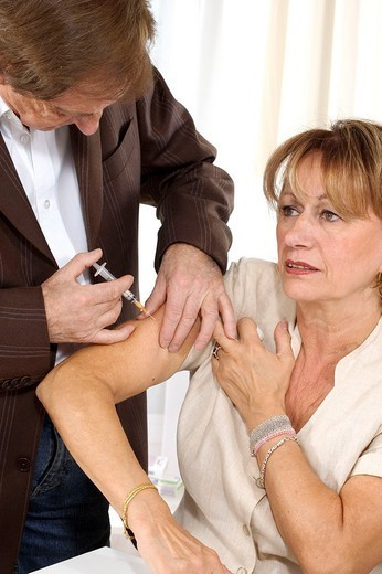 VACCINATING AN ELDERLY PERSON. VACCINATING AN ELDERLY PERSON Models. : Stock Photo