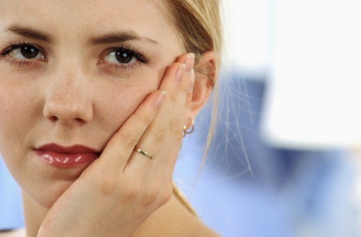 Stock Photo: 824-40525 PAINFUL TOOTH IN A WOMAN. PAINFUL TOOTH IN A WOMAN Model.