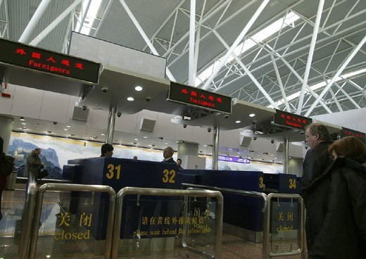AN AIRPORT. AN AIRPORT Photo essay. Peking Airport. Immigration, administration, tourists, customs check. : Stock Photo