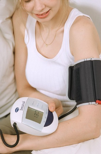Stock Photo: 824-41253 BLOOD PRESSURE, WOMAN. BLOOD PRESSURE, WOMAN Model.