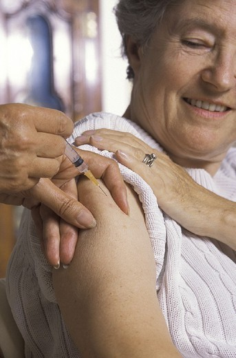 Stock Photo: 824-41963 VACCINATING AN ELDERLY PERSON. VACCINATING AN ELDERLY PERSON Models.
