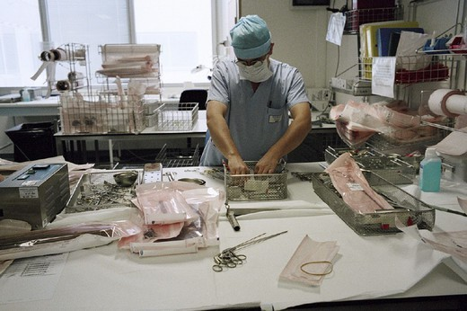 Stock Photo: 824-43043 STERILIZATION OF MED. EQUIPMENT. STERILIZATION OF MED. EQUIPMENT Photo essay from hospital. Sterilizing surgical equipment. Georges Pompidou hospital.