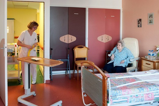 Stock Photo: 824-44542 NURSE DISPENSING CARE. Photo essay from hospital.