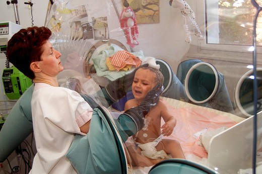 Stock Photo: 824-44870 IMMUNE DEFICIENCY. IMMUNE DEFICIENCY Photo essay. Necker Hospital for Children in Paris, France. Baby bubble. Child suffering immune deficiencies. Bathing.