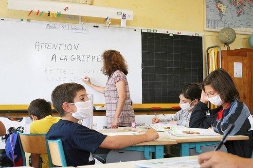 INFLUENZA PREVENTION. Simulation for influenza A prevention in a primary school. : Stock Photo