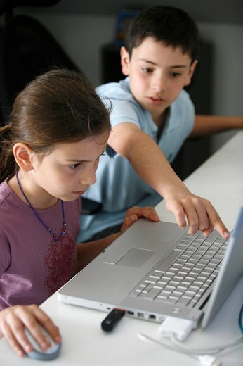 Stock Photo: 824-46045 CHILD, COMPUTER. CHILD COMPUTER Children using a computer.