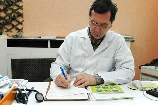Stock Photo: 824-46085 DOCTOR´S OFFICE. DOCTOR´S OFFICE A respirologist is writing a medical prescription.