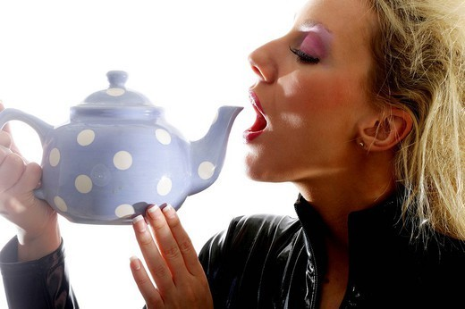WOMAN WITH HOT DRINK. WOMAN WITH HOT DRINK Worldwide distribution except for South Africa : Stock Photo