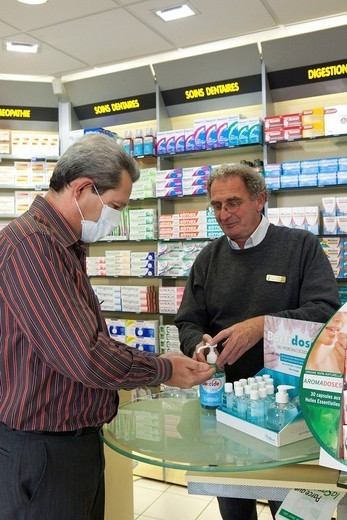 Stock Photo: 824-49358 INFECTION PREVENTION. Photo essay in a chemist´s shop. Prevention Influenza A/H1N1 , mask and alcohol hand rub.