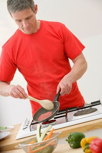 MAN IN KITCHEN. MAN IN KITCHEN Model. : Stock Photo