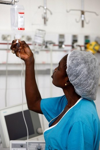 Stock Photo: 824-52224 NURSE. Nurse in intensive care in resuscitation room. Fann Hospital Dakar, Senegal.