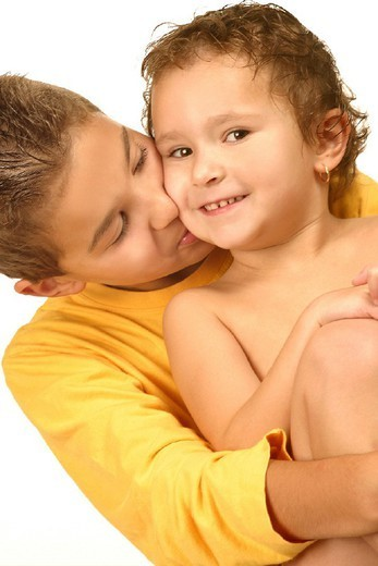 BROTHER & SISTER. BROTHER & SISTER Models. 3-year-old girl and 12-year-old boy. : Stock Photo