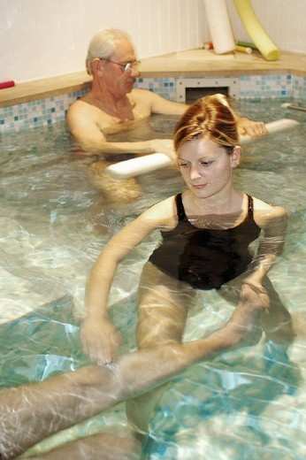 PHYSIOTHERAPIST. PHYSIOTHERAPIST Photo essay. Therapy pool at Dinan, in the Britanny region of France.   The sensation of weightlessness is the large advantage to re-education in a pool, thus facilitating the movement by alleviating stress to joints. Warm water (34°C) relaxes the muscles, the patient regains confidence by rediscovering ease of movement, and this flexibility is gradually integrated into daily activities. Pool re-education is principally indicated after surgery (lower limbs, : Stock Photo