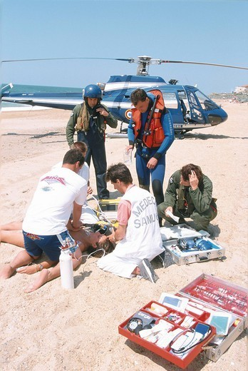 FIRST AID. Photo essay. Emergency medical service on the beach with helicopter. : Stock Photo