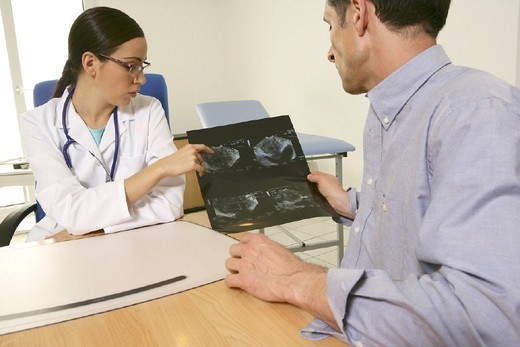 MAN AT HOSPITAL CONSULTATION. MAN AT HOSPITAL CONSULTATION Models. Ultrasound scan of the prostate. : Stock Photo