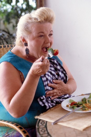 Stock Photo: 824-59788 WOMAN EATING. WOMAN EATING Model.
