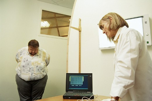 Stock Photo: 824-59860 OBESITY, TREATMENT. OBESITY, TREATMENT Measuring weight by metric impedance.