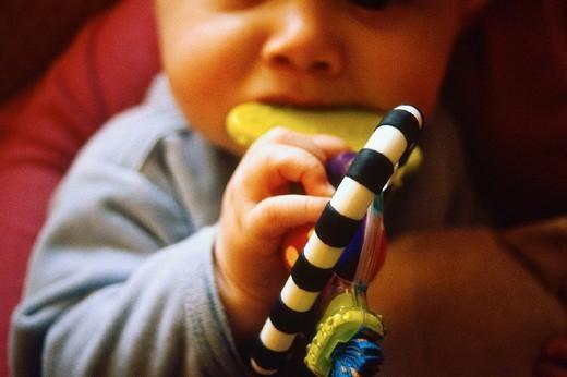 INFANT PLAYING INDOORS. INFANT PLAYING INDOORS Model. : Stock Photo