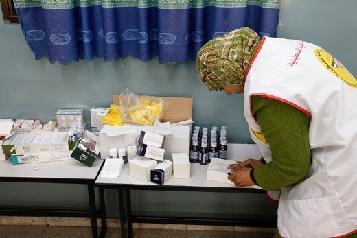 Stock Photo: 824-62445 HUMANITARIAN MEDICINE. Mobile Clinic of Physicians for Human Rights Balah, West Bank, occupied Palestinian territory. Chemist´s shop. Palestinian nurse.