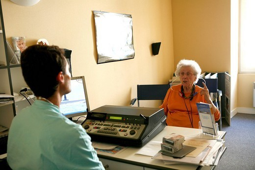 Stock Photo: 824-66169 AUDIOMETRY, ELDERLY PERSON. AUDIOMETRY, ELDERLY PERSON Otorhinolaryngologist.