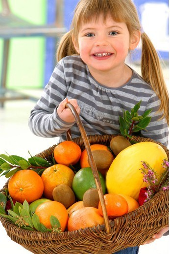 CHILD EATING FRUIT. Model. : Stock Photo