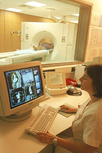 Stock Photo: 824-68850 CT SCANNER. CT SCANNER Photo essay from hospital. Georges Pompidou European Hospital in Paris, France. X-ray technician and patient. CAT scan of thorax.