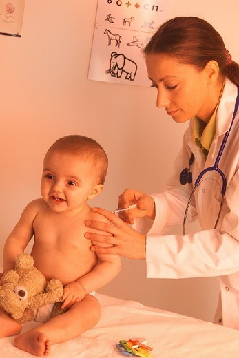 Stock Photo: 824-68912 VACCINATING AN INFANT. VACCINATING AN INFANT Models.