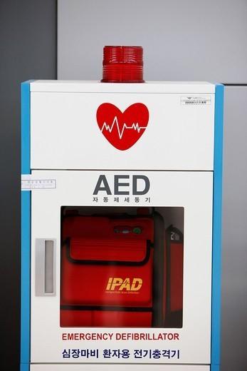 Stock Photo: 824-70225 AUTOMATED EXTERNAL DEFIBRILLATOR. Heart defibrillator at the aeroport of Seoul.