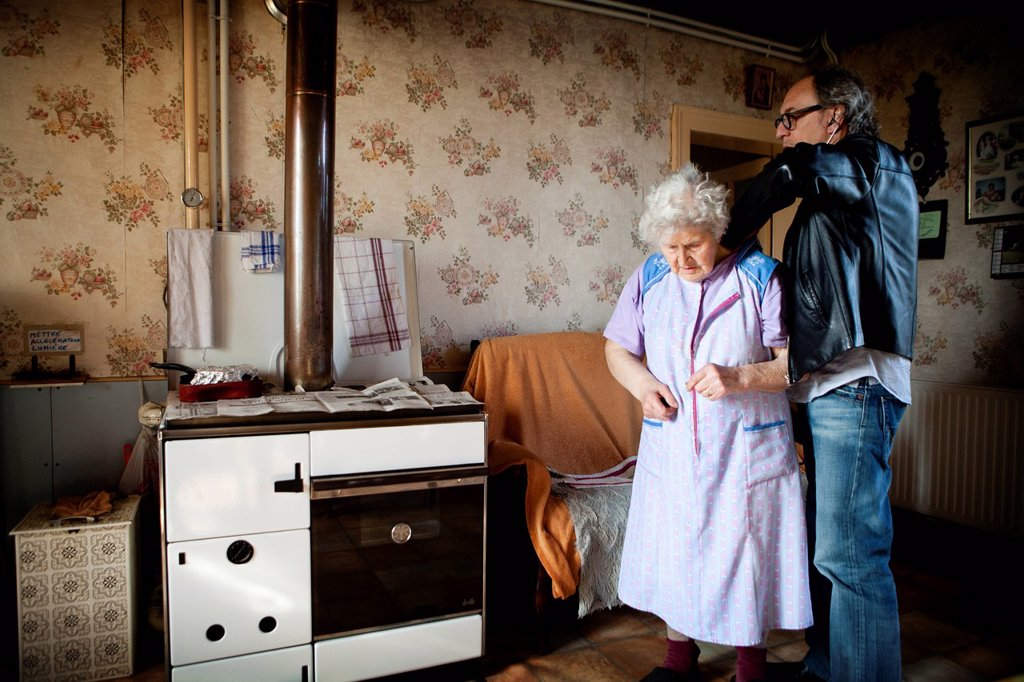 Stock Photo: 824-70443 HOME CONSULTATION ELDERLY PEOPLE. Photo essay on a country doctor in Picardie, France. He shares his time with consultations at his two offices and home visits. He has also launched an Emergency Medical Service.