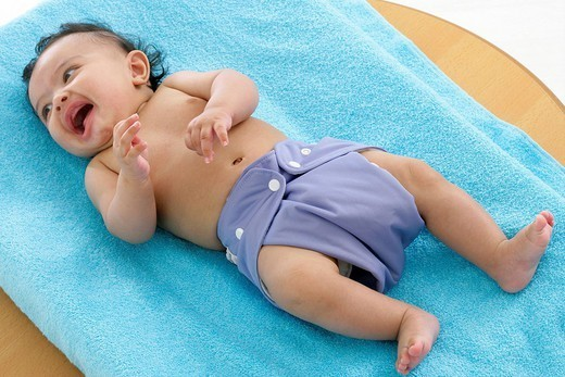 WASHABLE DIAPER. Model. 4_month_old baby boy with a washable diaper. : Stock Photo