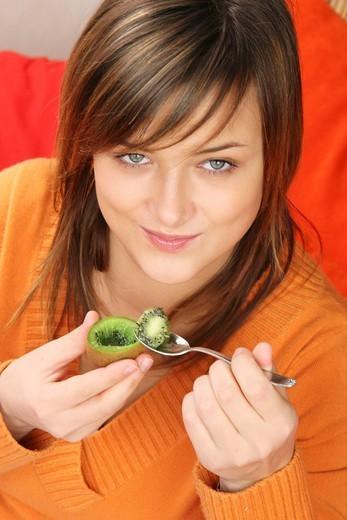 WOMAN EATING FRUIT : Stock Photo