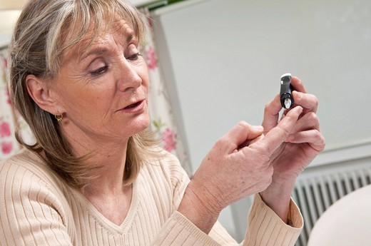 TEST FOR DIABETES ELDERLY PERSON. Model. : Stock Photo