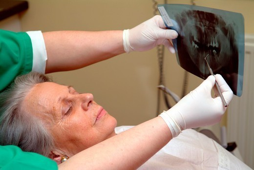 Stock Photo: 824-76807 DENTAL CARE FOR ELDERLY PERSON. DENTAL CARE FOR ELDERLY PERSON Photo essay from dental office.