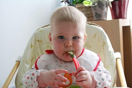 INFANT EATING. Model. Baby girl. : Stock Photo