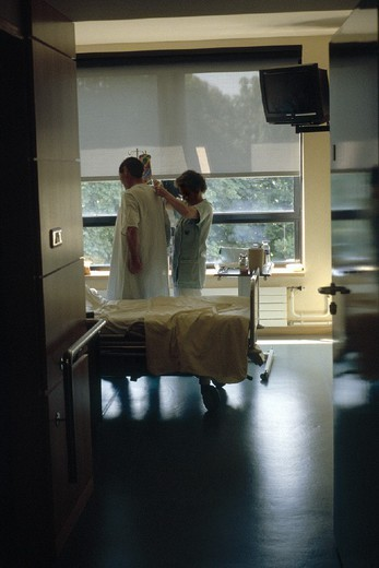 Stock Photo: 824-78186 MAN HOSPITAL PATIENT W. NURSE. MAN HOSPITAL PATIENT W. NURSE Photo essay from hospital. Nurse and patient.
