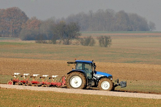 Stock Photo: 824-78297 AGRICULTURE, PLOUGHING. Farmer plowing with a reversible mouldboards plow Oise, Picardy, France.
