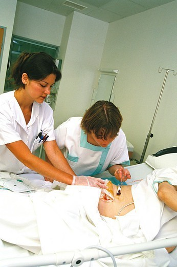 NURSE DISPENSING CARE. NURSE DISPENSING CARE Photo essay. Chatellerault Hospital (Camille Guérin Hospital) in the French department of Vienne. : Stock Photo