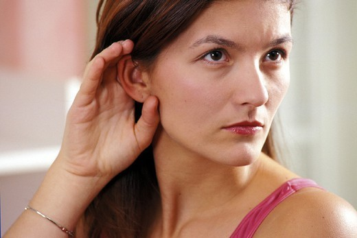 HEARING-IMPAIRED WOMAN. HEARING-IMPAIRED WOMAN Model. : Stock Photo