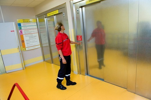 FIRE SECURITY. Photo essay at the hospital of Meaux 77, France. Fire safety agent. Monitoring of the elevators. : Stock Photo