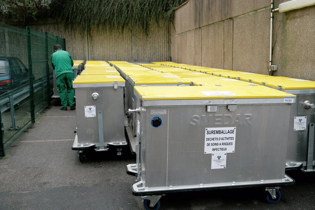 Stock Photo: 824-82814 REFUSE COLLECTION. Photo essay at Rouen hospital, France. Collection of yellow bins, containing medical wastes.