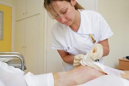 Stock Photo: 824-83219 BANDAGE. BANDAGE Photo essay from clinic. Nurse. Orthopedic clinic. Change of the bandage.