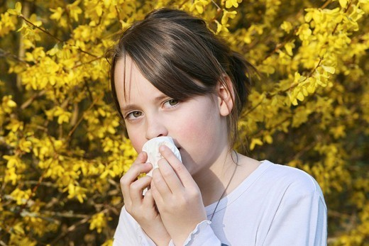 Stock Photo: 824-84779 CHILD WITH RHINITIS. CHILD WITH RHINITIS Model. 11_year_old girl.