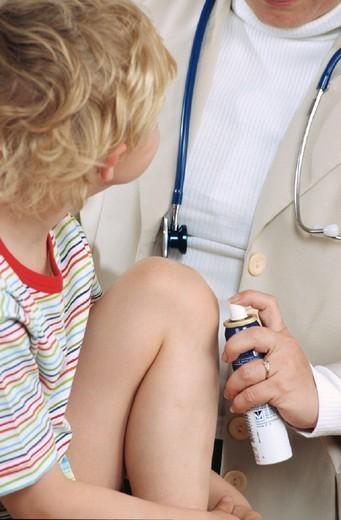 PEDIATRICS. PEDIATRICS Models. Disinfection of wound. : Stock Photo