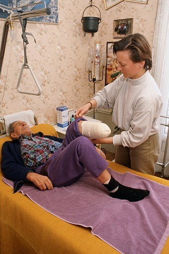 HOME MEDICAL CARE FOR ELDERLY P. HOME MEDICAL CARE FOR ELDERLY PEOPLE Photo essay. Nurse caring for amputee´s stump. : Stock Photo