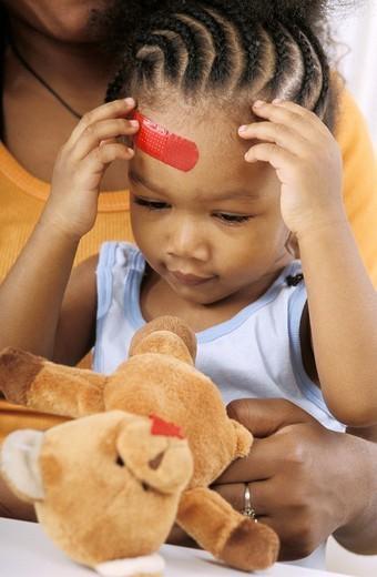 BANDAGE. BANDAGE Models. 18-month-old girl. : Stock Photo