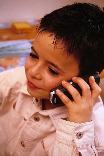 CHILD TELEPHONING. CHILD TELEPHONING Model. : Stock Photo