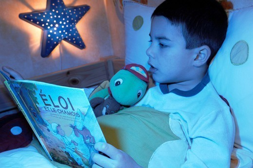 CHILD READING. CHILD READING Model. 5_and_half_year_old boy. : Stock Photo
