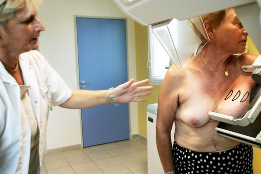 MAMMOGRAPHY EXAMINATION. Photo essay from hospital. Medical examination for the prevention of breast cancer at Aubagne medical center, France. The technician is helping the patient to position correctly on the mammogram. : Stock Photo