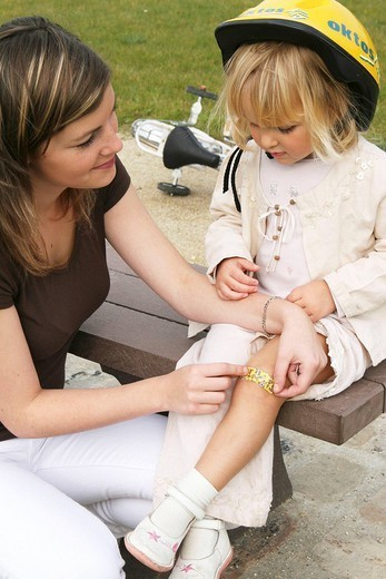 WOUND CARE, CHILD. WOUND CARE, CHILD Models. : Stock Photo