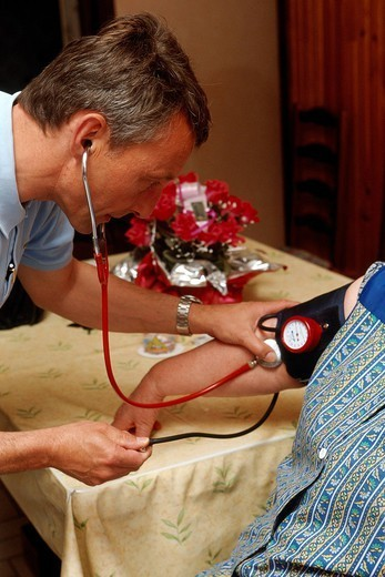 HOME CONSULTATION ELDERLY PEOPLE. Photo essay. Patient and doctor. Taking blood pressure. : Stock Photo